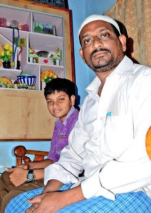 The Committee Secretary Sheik Hussain with his son. / Photo: T. Appala Naidu / The Hindu
