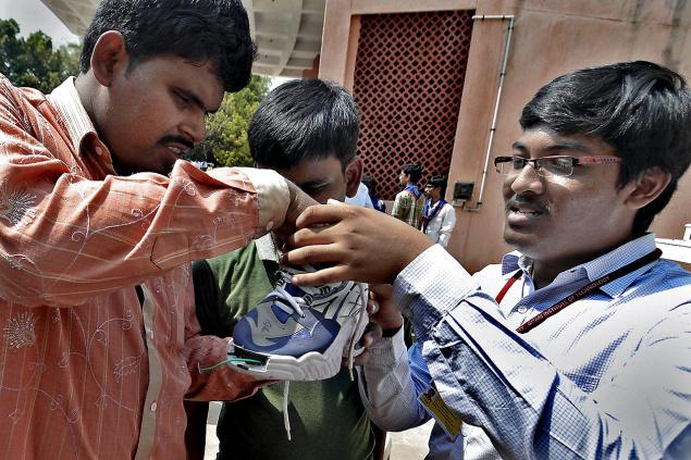 Visakhapatnam: 15/03/2014: I. Krishna Sai, a student of third year Industrial Engineering of GITAM University, explaining about his innovation of a shoe with sensors to visually challenged people in Visakhapatnam on Saturday, March 15, 2014. ---/ The Hindu