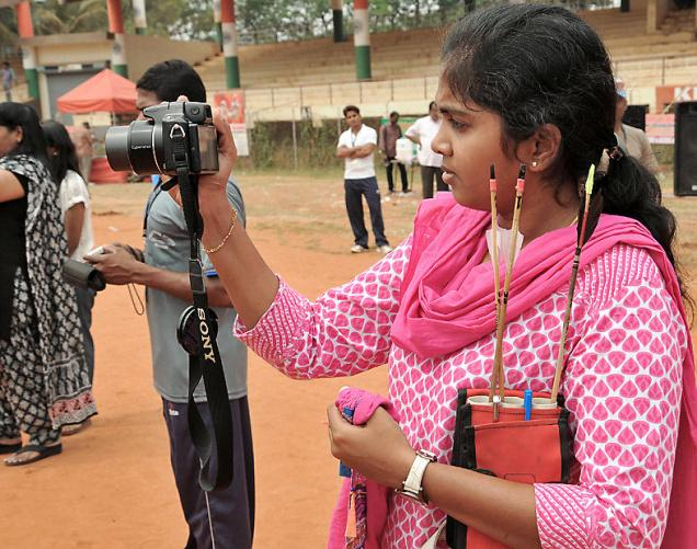 Women trying to capture pictures of the 'National Mini Archery Competitions' , held at IGMC stadium in Vijayawada on Thursday. / Photo: Ch.Vijaya Bhaskar / The Hindu