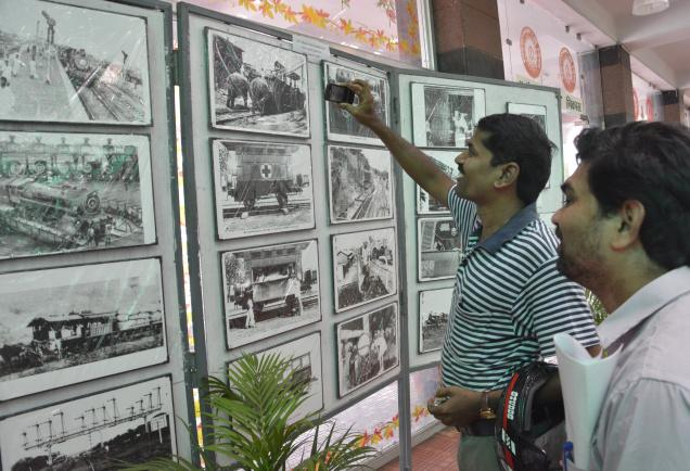 A visitor records the exhibits on his mobile at the exhibition organised as part of the Railway Week celebrations, in Visakhapatnam on Wednesday. /  Photo: C.V. SUBRAHMANYAM / The Hindu
