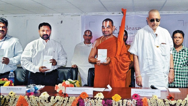 Sri Tridandi Chinna Jeeyar Swamy (2nd right) releasing the book 'Stray Thoughts on Political Economy' written by P Anand Gajapathi Raju (right), chairman of MANSAS Trust, at the MGVR College of Engineering campus in Vizianagaram on Monday | Express Photo