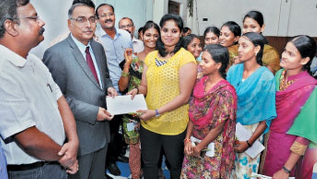 Krishna University vice-chancellor V Venkaiah presenting cheques to Women Kabadi players at PB Siddhartha College in Vijayawada on Friday. Registrar D Suryachandra Rao (left) looks on | EXPRESS PHOTO