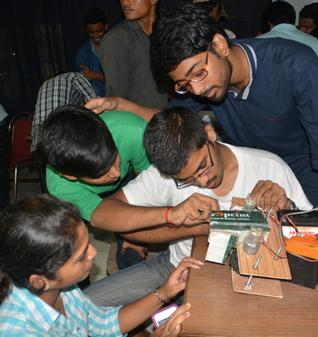 Students participating in the preliminary round of the national-level robotic competition, 'Escalade III', organised by IIT-Guwahati at Andhra University in Visakhapatnam on Sunday. - Photo: C.V. SUBRAHMANYAM