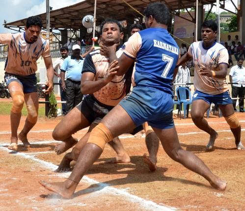 Andhra Pradesh and Karnataka Players in action in the final match of the 14th All India BSNL Kabaddi tournament in Vijayawada on Friday. _ PHOTO: V_RAJU. / The Hindu