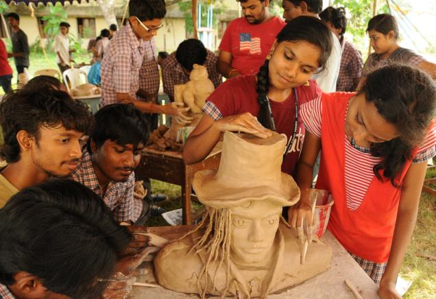 Students giving final touches to the clay model at a workshop in Andhra Loyola College in Vijayawada. Photo. Ch. Vijaya Bhaskar. / The Hindu