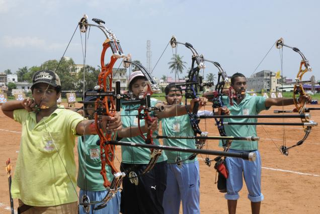 Archers participating in the inter-district championship in the city on Sunday. -Photo: C.V. Subrahmanyam / The Hindu