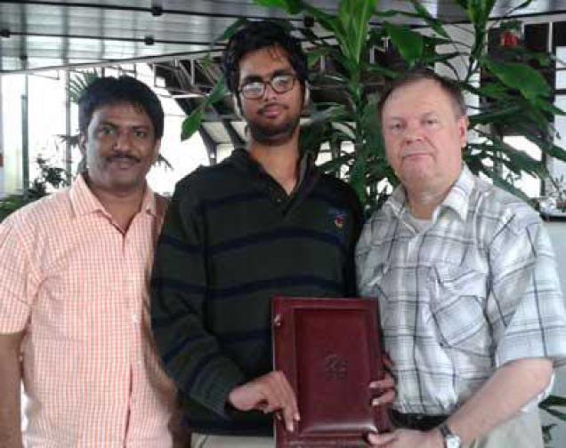 City chess player K.V.K. Karthik receiving FIDE Master title from IPCA president Pilimon Zbigniew at Serbia. Also seen is Karthik's coach Shaik Khasim. Photo: By Arrangement / The Hindu