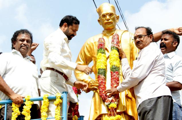 Collector Kantilal Dande garllanding a statue of poet Gurram Jashuva on the latter's 119th birth anniversary in Guntur on Sunday. PHOTO: T. Vijaya Kumar / The Hindu