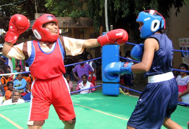 Women boxers in action at the finals of AP State Women Sports Meet at B.R. Stadium in Guntur on Friday. Photo: T. Vijaya Kumar / The Hindu