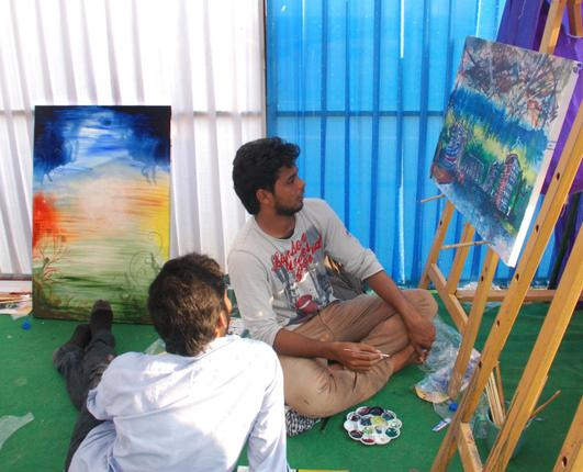 Artists working on their idea of the City of Visakhapatnam emerging from the devastation caused by Cyclone Hudhud at a two-day Art Camp in Visakhapatnam on Sunday. Photo: C.V. Subrahmanyam / The Hindu