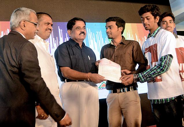 Minister for IT Palle Raghunath Reddy handing over a memorandum of understanding to a group of young entrepreneurs at the first bootcamp at the Sunrise Startup Village in Visakhapatnam on Thursday. -Photo: C.V. Subrahmanyam