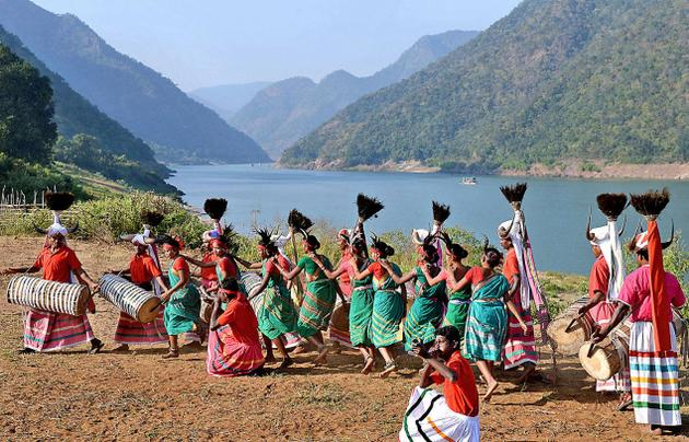 Tribals in their traditional gear regaling tourists in the backdrop of the picturesque Papikondalu Hills. Photo: K.R. Deepak