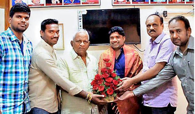 Andhra Pradesh Badminton Association office secretary Prasad was honoured by the BAI officials in Vijayawada on Friday.—Photo: By Arrangement