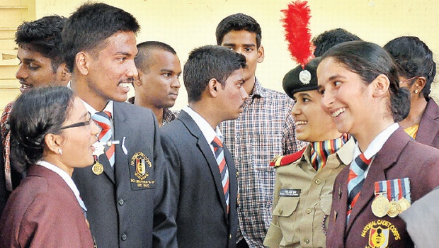 NCC cadets of Andhra Loyola College, who participated in the Republic Day celebrations in New Delhi, shares a light moment before being felicitated by Krishna district collector Babu A on the college premises in Vijayawada on Tuesday | Express Photo