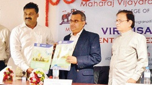 (Left) MVGR College of Engineering principal KVL Raju and Virtusa Consulting Services vice-president Madhavan Seshadri (centre) releasing a brochure in Vizianagaram on Monday. MVGRCE correspondent A Raghava Rao is at right | Express Photo