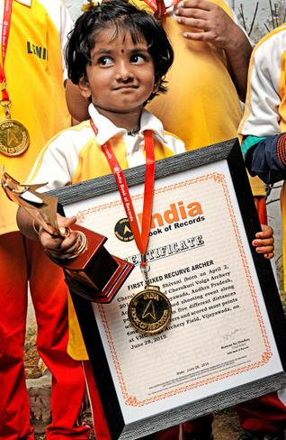 Child prodigy:Archer Dolly Shivani who entered the India Book of Records by emerging as the country's first mixed recurve archer in Vijayawada on Sunday.— Photo. Ch. Vijaya Bhaskar