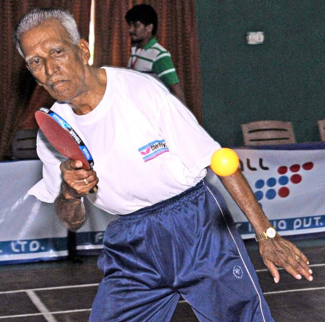 Vizag's octogenerian paddler D. Kesava Rao in action at the Futureall 1st AP State Table Tennis Championship at Vijayawada Club on Sunday. Photo: CH. Vijaya Bhaskar