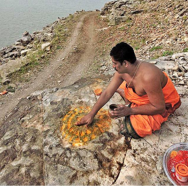 Vedic pandit Telakapalli Raghurama Sarma applying turmeric near Sangameswara Temple in Kurnool district.