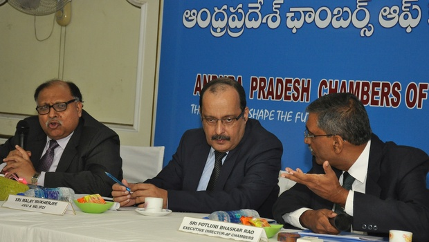 IFCI CEO Malay Kumar Mukherjee (centre) interacts with APCCIF executive director P Bhaskara Rao (right) at an interactive session organised by the APCCIF in Vijayawada on Thursday as deputy managing director of IFCI Achal Kumar Gupta looks on | Express Photo