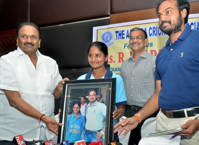 ACA general secretary Gokaraju Ganga Raju felicitating cricketer Kalpana, who played for the country, at a function in Vijayawada on Sunday.—Photo: V. Raju