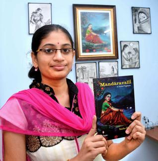 Sneha Deepti with her first book 'Mandaravalli, A Veiled Vigilante' in Visakhapatnam.— PHOTO: C.V. SUBRAHMANYAM