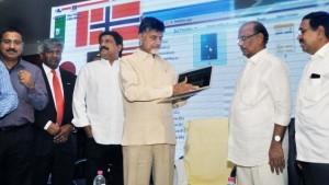 Chief Minister N. Chandrababu Naidu launching the website of the AP Non-Resident Telugu Corporation in Tirupati on Wednesday. Ministers Ganta Srinivasa Rao, B. Gopalakrishna Reddy, and P. Narayana, and TANA members Komati Jayaram and Satish Vemana are seen.—Photo: K.V. Poornachandra Kumar