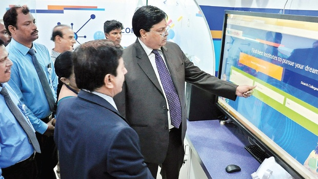 SBI chief general manager Hardayal Prasad and DGM Rajiv Kohli (2nd left) and regional manager GV Sastry during the inauguration of SBI Intouch (digital branch) at Governorpet in Vijayawada on Thursday | Express