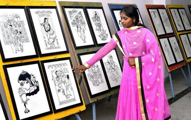 G. Nirmala Tejasri explaining her drawings exhibited at Bapu museum, in Vijayawada on Thursday. | Photo Credit: V_RAJU.