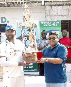 Narra Mahesh receiving a trophy from a Ghanaian cricket official at Accra.