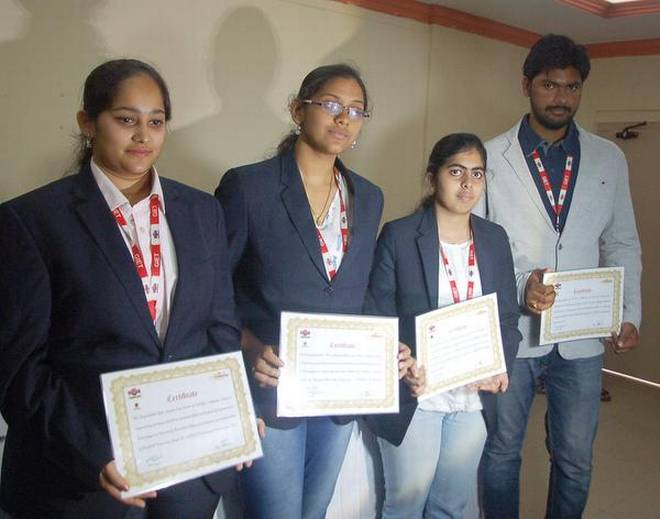 Achievers: The students selected for Stanford University Innovation Fellow programme with their certificates in Rajamahendravaram on Wednesday.