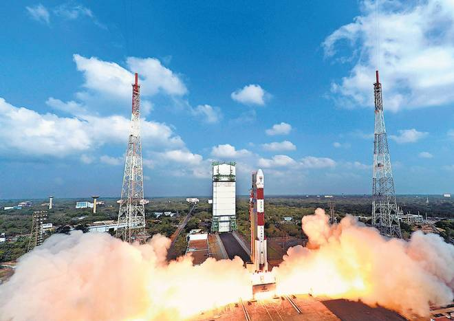 RECORD HAUL: The PSLV-C37 blasting off from the Satish Dhawan Space Centre in Sriharikota with 104 satellites on Wednesday.   | Photo Credit: PTI