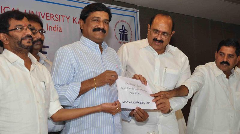Ministers Ganta Srinivasa Rao, Somireddy Chandram-ohan Reddy, Kamineni Srinivas and Adi Narayan Reddy release Eamcet results in Vijayawada on Friday.(Photo: DC)