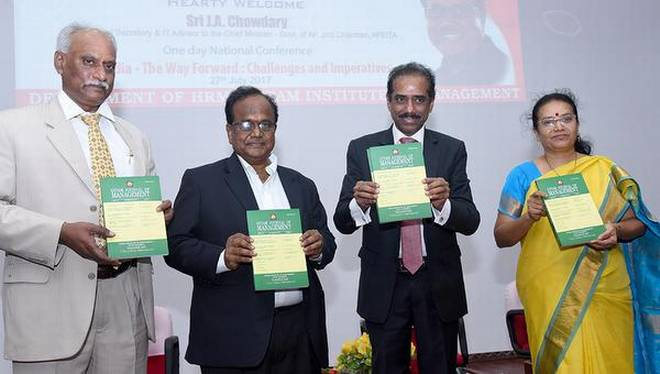 IT Advisor J.A. Chowdary (second from left) and CEO of Capgemini K . Srinivas (third from left) releasing a book. | Photo Credit: Special Arangement