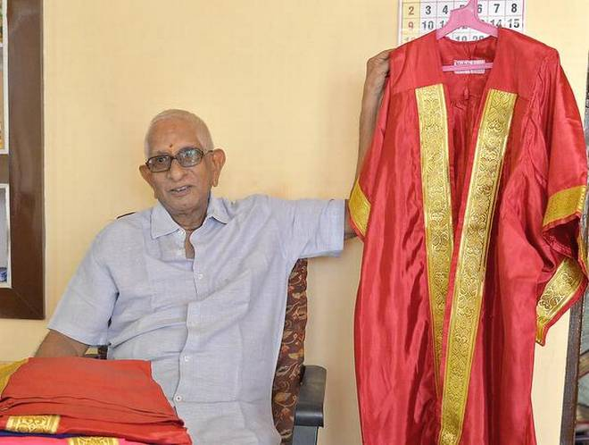 M.S.R. Murty showing the VIP robes ahead of the AU convocation, in Visakhapatnam on Wednesday. | Photo Credit: K_R_DEEPAK