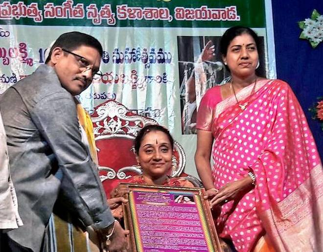 Carnatic vocalist Dwaram Lakshmi receiving the M.S. Subbulakshmi memorial award from K.S. Govindarajan, principal, Government College of Music and Dance, and ZP chairperson Gadde Anuradha, at a function in Vijayawada on Saturday. | Photo Credit: ARRANGED