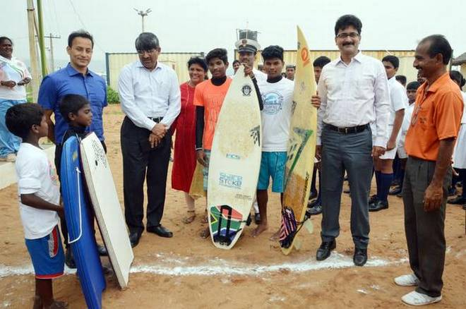 Principal Secretary for Sports L.V.Subrahmanyam interacting with the water sports students during his visit to Rushikonda in Visakhapatnam on Saturday. Collector Pravin Kumar looks on.   | Photo Credit: arranged