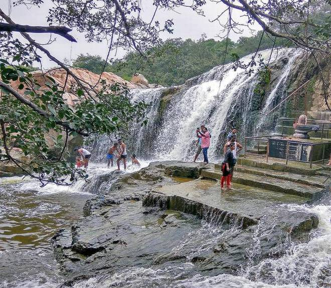 Picturesque spot: Kaigal waterfalls was the youngsters' choice destination in Chittoor district. | Photo Credit: By Arrangement