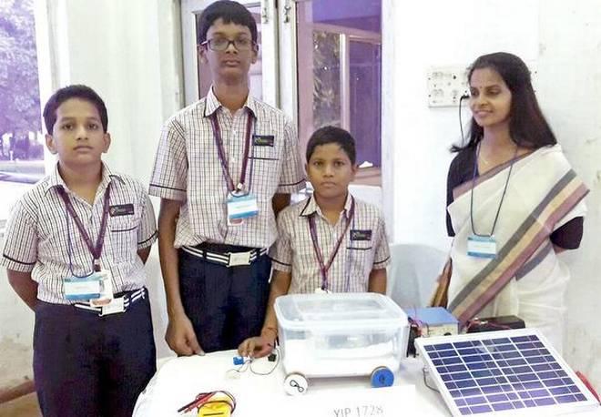 Students of The Crossword School, Guntur —Vijayaditya Reddy, M. Sudhamsu and G.Vishnu Teja— with 'cool push cart' designed by them.