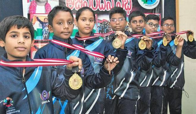 Proud moment:Students displaying the medals they won in the Pencak Silat event heldin Singapore, at Ongole.Kommuri SrinivasKommuriSrinivas