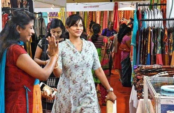 Visitors at an exhibition in Vijayawada on Thursday. | Photo Credit: V_RAJU.