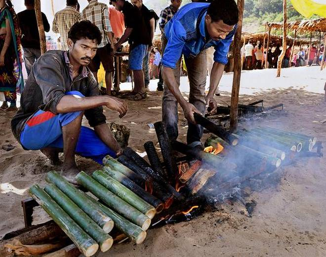 Tradition on a plate:Tribal youth cooking 'bamboo chicken' at a tourist spot in Kollur on the banks of Godavari.G.N. RAOG_N_RAO