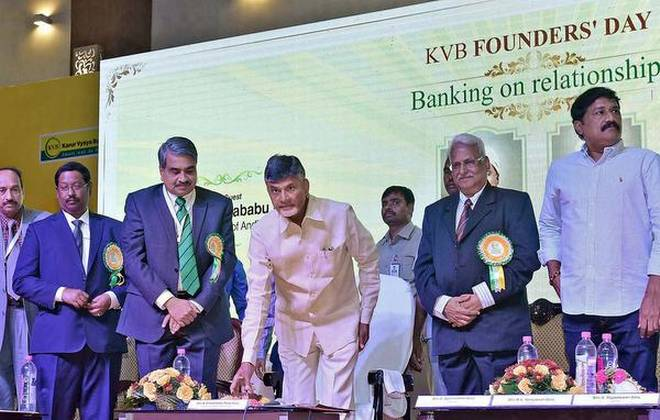 Chief Minister N. Chandrababu Naidu pressing a button to inaugurate the 'digital village' at Bandarupalli in Guntur district, during the 101st Founder's Day celebrations of Karur Vysya Bank (KVB) in Visakhapatnam on Saturday. | Photo Credit: arranged