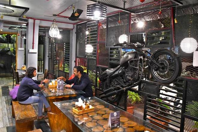 People hanging out at the newly opened Gluttons Garrage restaurant | Photo Credit: K_R_DEEPAK