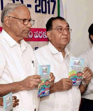 Vizag Fest chairman K.V. Ramana, right, and secretary A. Aja Sarma releasing a pamphlet on the festival in Visakhapatnam on Wednesday.