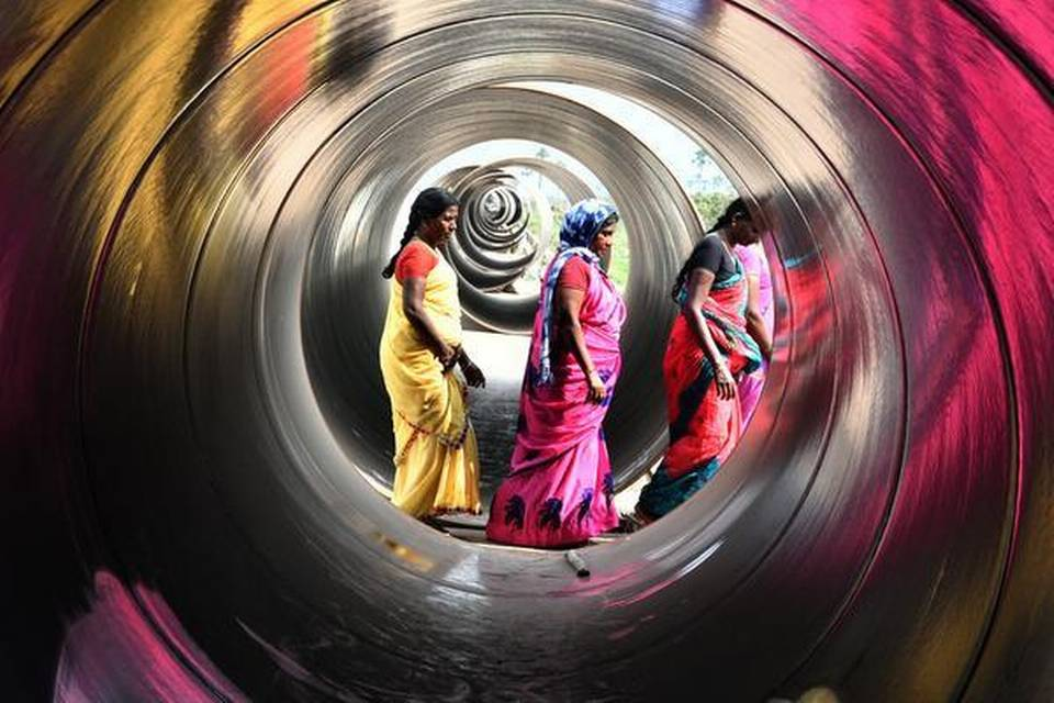 This photograph has been selected second prize in the Press Club Hyderabad Photo contest this year. Women from a nearby village walk between huge pipes used in the construction activity at Mandadam in the core capital region near Vijayawada of AP, | Photo Credit: CH_VIJAYA BHASKAR